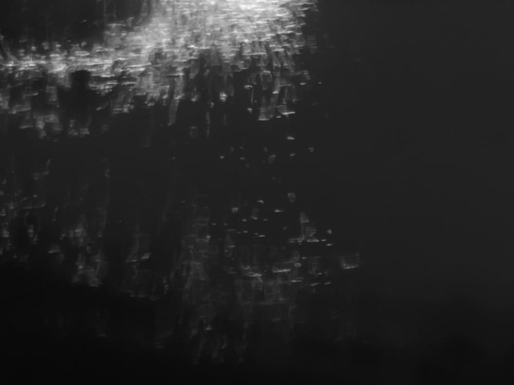 close up of some sparks reflected in water and converted to black and white